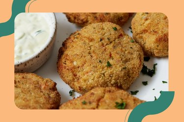 Air Fryer Fish Salmon Patties on a white plate with a white dipping sauce