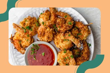 Air Fryer Fish Coconut Shrimp on a white plate with red dipping sauce