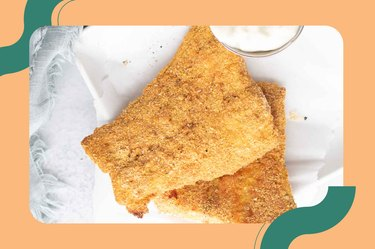 Air Fryer Fish on a white plate with white dipping sauce