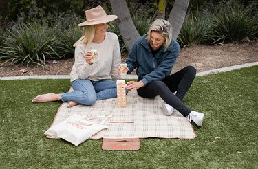 two women outdoors sipping on Zevia Creamy Root Beer