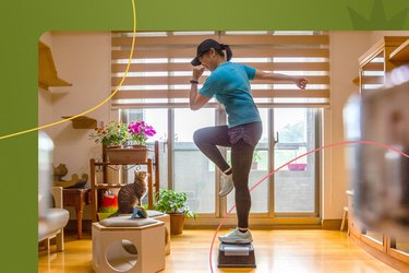 Woman doing step-ups during 4-week legs challenge at home