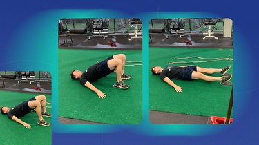 athletic man doing a glute bridge and hamstring curl exercise