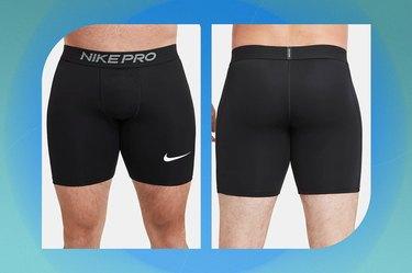 black nike pro men's shorts on a blue-green background