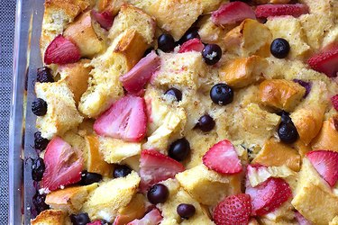 High Protein Mixed Berry French Toast Casserole with strawberries and blueberries