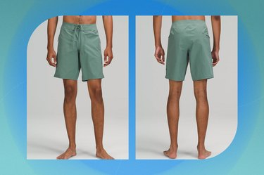 """sea green lululemon current state board short 9"""" on a blue-green background"""