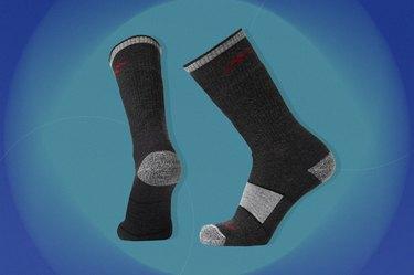 black and grey darn tough hiker boot full-cushion socks on a blue-green background