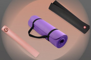 illustration of pink, purple and black yoga mats on a pink and black background