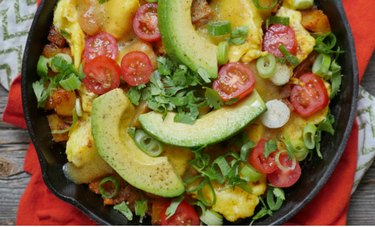 Spiced Potato and Egg Breakfast Skillet with Avocado with a red cloth napkin