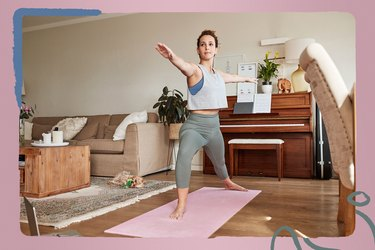 person doing 30-day yoga challenge at home on pink yoga mat