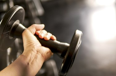 a closeup of a hand doing a dumbbell wrist curl exercise