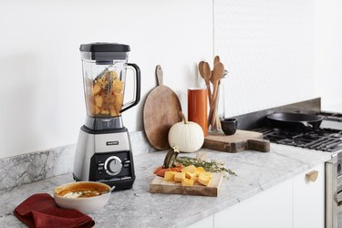 hurom blender on counter with fall foods