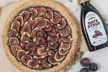 D'Vash Organics date syrup along a homemade fig tart