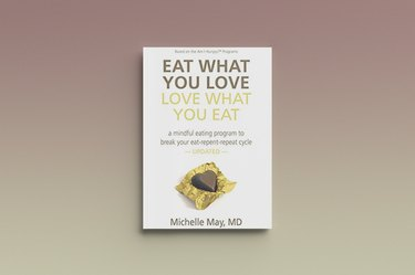 Eat What You Love, Love What You Eat by Michelle May, against a gray background