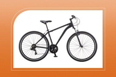 schwinn gtx 3 men's hybrid bike in black on an orange background
