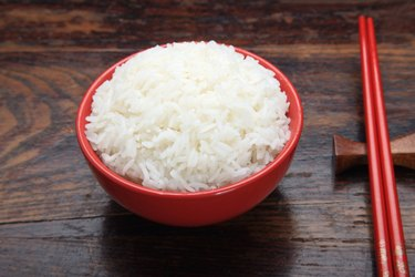 Close-up of a bowl of rice with chopsticks