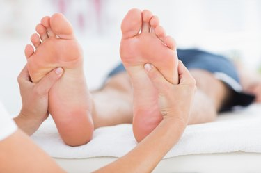 Man having feet massage