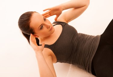 woman working out in fitness doing situp abs isolated