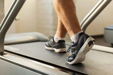 Exercising on treadmill.