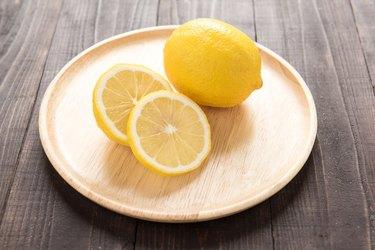 Fresh lemons on wooden background