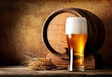 Wooden barrel and beer