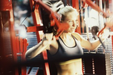 Close-up of a young woman exercising in a gym