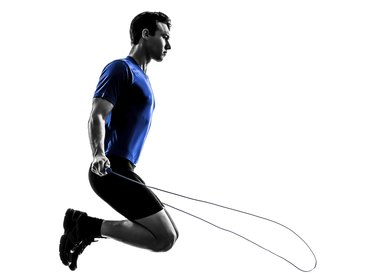 young man exercising jumping rope silhouette