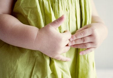 Child putting hands on stomach