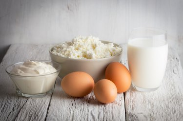Fresh dairy products and eggs on rustic wooden table