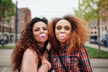 Best friends chewing bubble gum