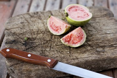 Guava on old wooden chopping board