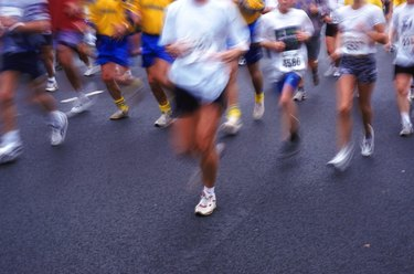 Marathon runners on road, low section
