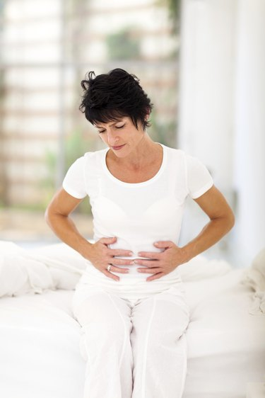 middle aged woman having constipation