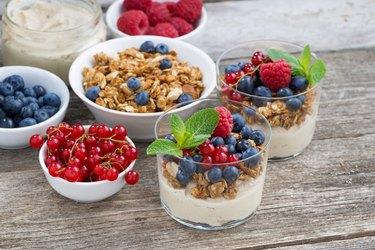 dessert with sweet cream, fresh berries and granola