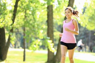 Runner - woman running in park
