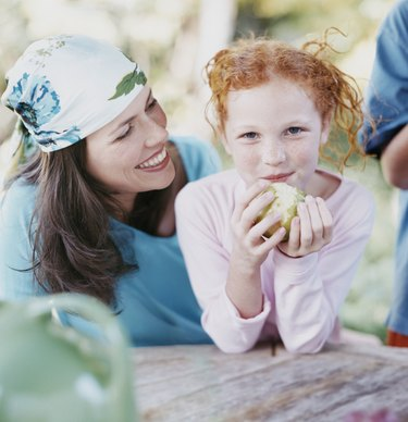 Portrait of a Young Girl and Her Mother, Girl Eating an Apple