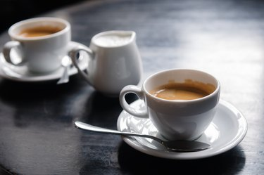two coffee cups on table in cafe
