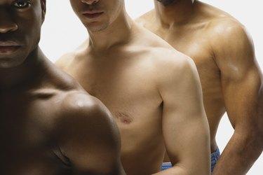 Multi-ethnic bare cheated men in row