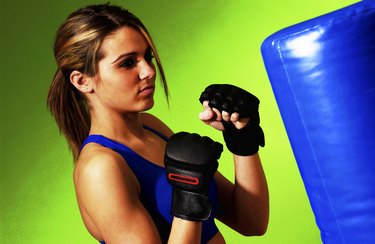 Woman practicing boxing