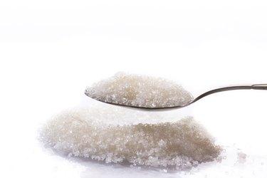 granulated sugar in a spoon