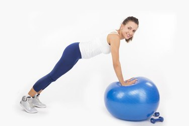 Woman doing a plank on an exercise ball. Please view all pictures of this model plus other fitness & exercise images in my portfolio.