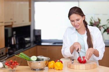 Woman slicing a pepper
