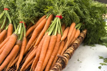 carrots in a basket on white table at farmers market