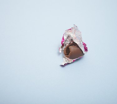 Chocolate egg partially wrapped in foil