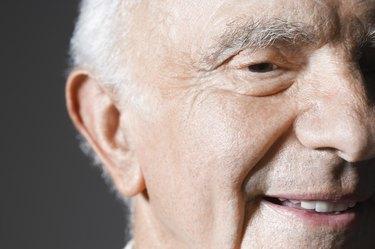 Senior man in studio, close up