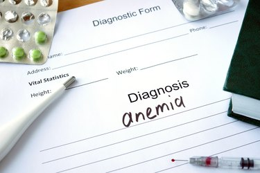 Diagnostic form with Diagnosis anemia and pills.