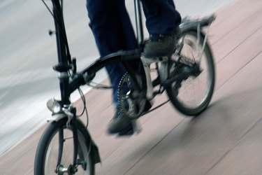 Person riding folding bicycle.