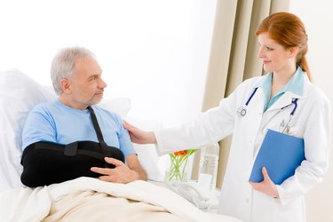 Hospital - female doctor examine senior patient