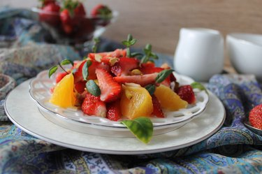 fruit salad with strawberries, oranges, pistachios