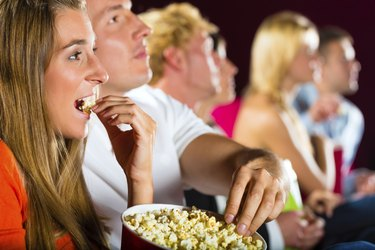 Young people watching movie at cinema
