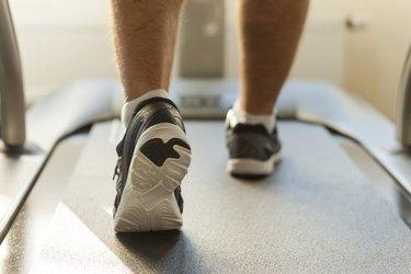 Walking on treadmill.